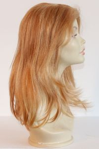 available for rent: cherry blonde human hair wig with lighter blonde streaks, in human hair, natural skin top